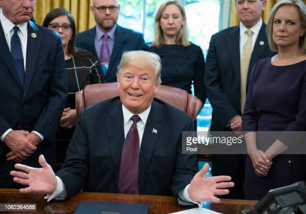 US President Donald Trump speaks during a signing of the Cybersecurity and Infrastructure Security Agency Act in the Oval Office of the White House...