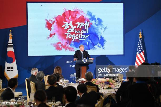 US President Donald Trump speaks during a state dinner with South Korea's President Moon JaeIn at the presidential Blue House in Seoul on November 7...