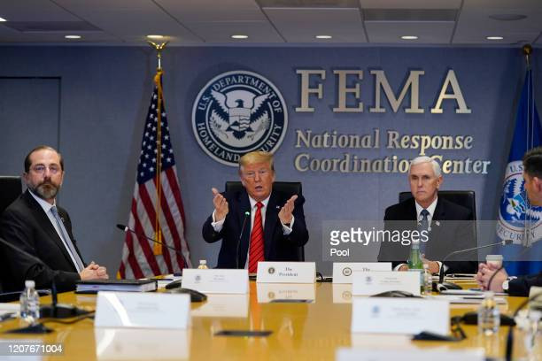 President Donald Trump speaks during a teleconference with governors at the Federal Emergency Management Agency headquarters, From left, Department...