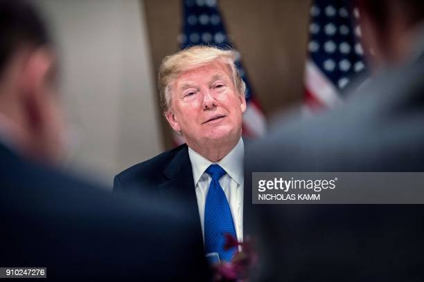 US President Donald Trump speaks during a working dinner with European business leaders during the World Economic Forum annual meeting in Davos...