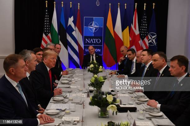 US President Donald Trump speaks during a working lunch at the NATO summit at the Grove hotel in Watford northeast of London on December 4 2019