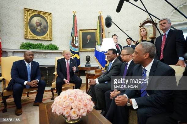 US President Donald Trump speaks during a working session regarding opportunity zones following the recently signed tax bill in the Oval Office of...