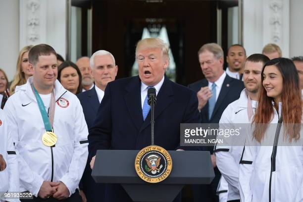 US President Donald Trump speaks during an event honoring the US Olympic team in the North Portico of the White House on April 27 2018 in Washington...