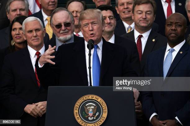 S President Donald Trump speaks during an event to celebrate Congress passing the Tax Cuts and Jobs Act with Republican members of the House and...
