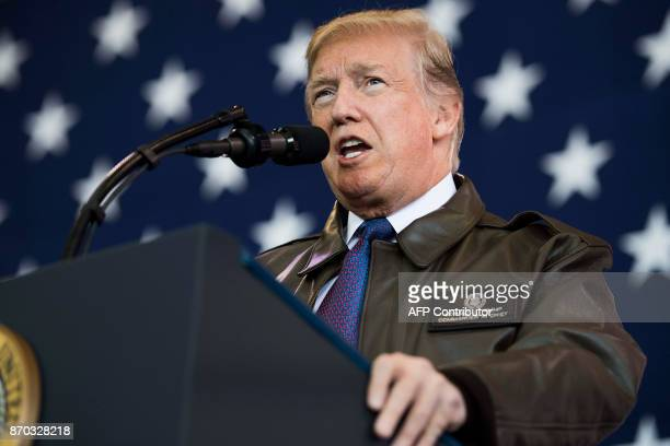 US President Donald Trump speaks during an event with US military personnel at Yokota Air Base at Fussa in Tokyo on November 5 2017 Trump touched...
