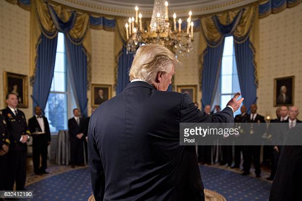 S President Donald Trump speaks during an Inaugural Law Enforcement Officers and First Responders Reception in the Blue Room of the White House on...