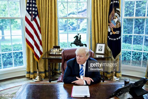 S President Donald Trump speaks during an interview in the Oval Office of the White House in Washington DC US on Monday May 1 2017 The one year...