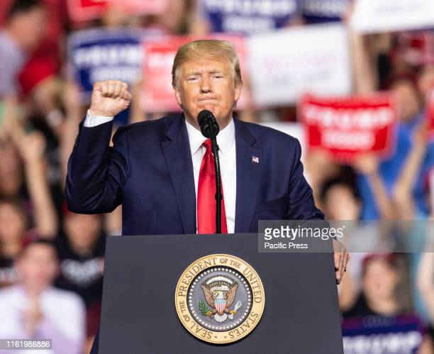 President Donald Trump speaks during campaign MAGA rally at Southern New Hampshire University Arena