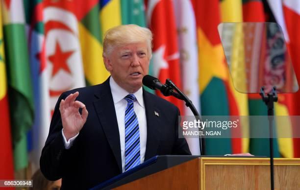 US President Donald Trump speaks during the Arab Islamic American Summit at the King Abdulaziz Conference Center in Riyadh on May 21 2017 Trump tells...