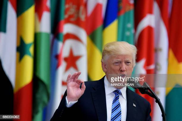 US President Donald Trump speaks during the Arab Islamic American Summit at the King Abdulaziz Conference Center in Riyadh on May 21 2017 / AFP PHOTO...