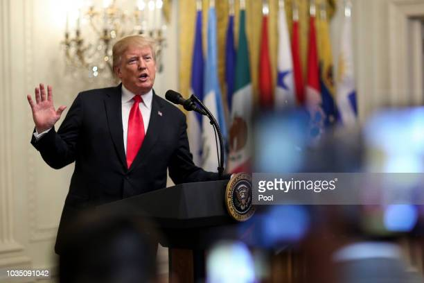 President Donald Trump speaks during the Hispanic Heritage Month Celebration in the East Room of the White House on September 17 2018 in Washington...