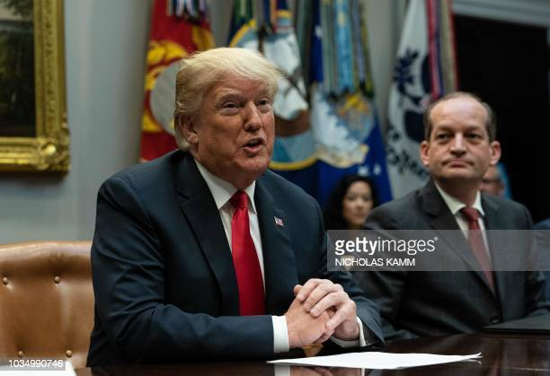US President Donald Trump speaks during the inaugural meeting of the Presidents National Council for the American Worker as Labor Secretary Alex...