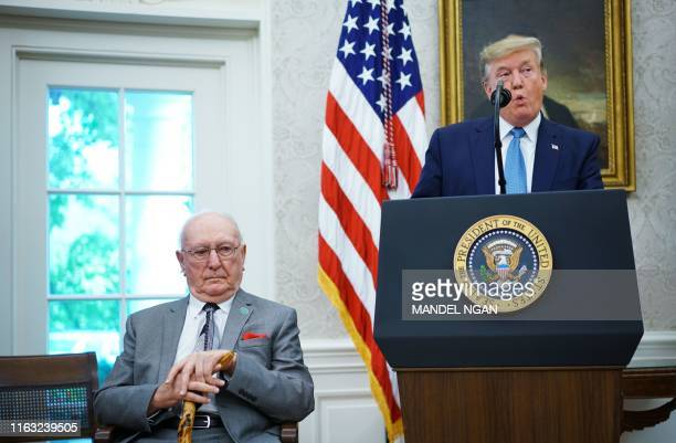 US President Donald Trump speaks during the presentation ceremony for the Presidential Medal of Freedom to Celtics basketball legend Bob Cousy in the...