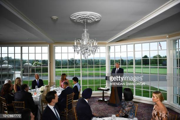 US President Donald Trump speaks flanked by First Lady Melania Trump Boeing CEO Dennis Muilenburg CEO of PepsiCo Indra Nooyi and his Special Advisor...