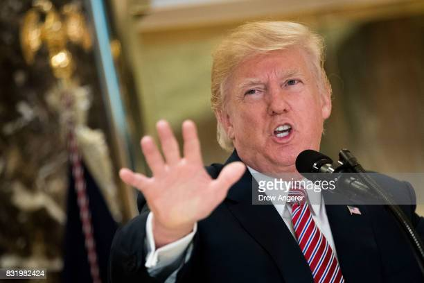 President Donald Trump speaks following a meeting on infrastructure at Trump Tower August 15 2017 in New York City He fielded questions from...