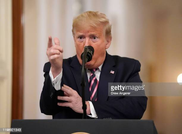 S President Donald Trump speaks in the East Room of the White House one day after the US Senate acquitted on two articles of impeachment ion February...