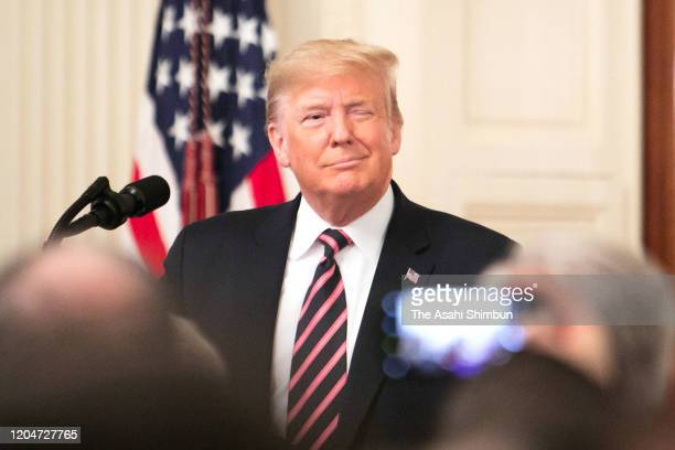 S President Donald Trump speaks in the East Room of the White House one day after the US Senate acquitted on two articles of impeachment on February...