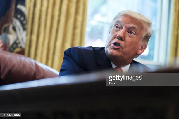 President Donald Trump speaks in the Oval Office during an event commemorating the repatriation of Native American remains and artifacts from Finland...