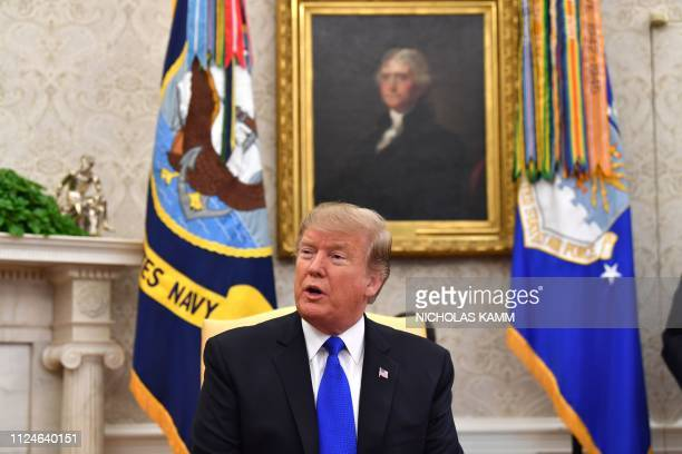 US President Donald Trump speaks in the Oval office of the White House in Washington DC on February 13 2019 Trump hosted his Colombian counterpart...
