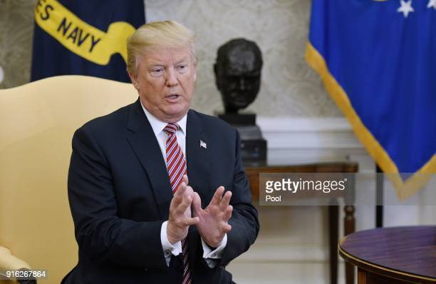 US President Donald Trump speaks in the Oval Office of the White House February 9 2018 in Washington DC President Donald Trump gave a $10000 check to...