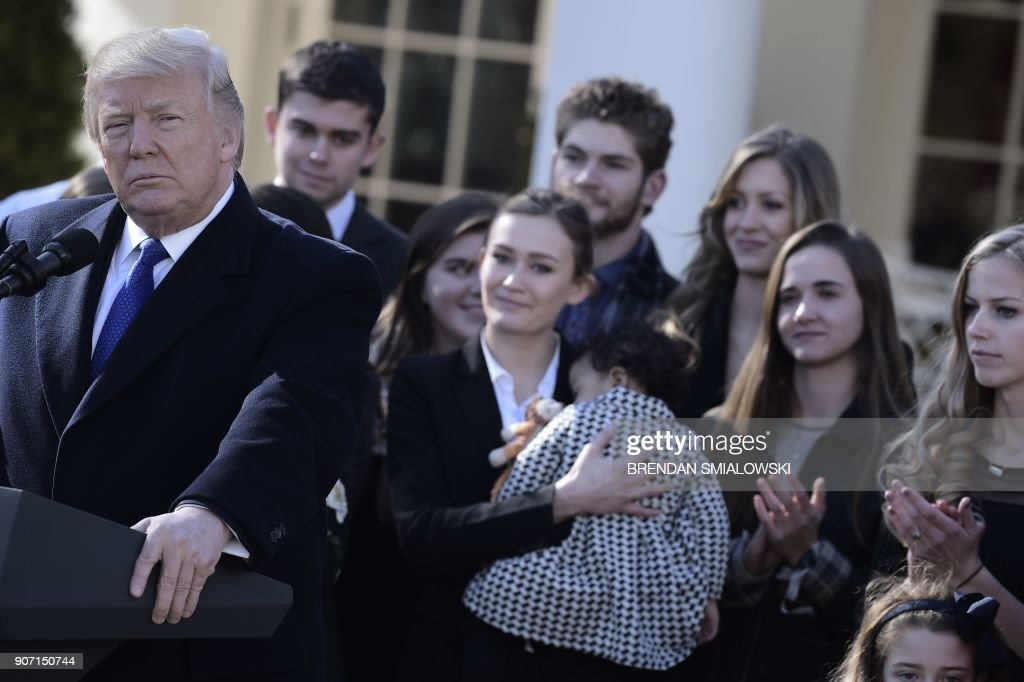 US President Donald Trump speaks live via video link to the annual 'March for Life' participants and anti-abortion leaders on January 19, 2018 from the White House in Washington,DC. The 45th edition of the rally, which describes itself as 'the world's largest pro-life event,' takes place on the National Mall -- with other scheduled speakers including House Speaker Paul Ryan. / AFP PHOTO / Brendan SMIALOWSKI