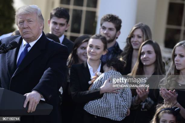 US President Donald Trump speaks live via video link to the annual 'March for Life' participants and antiabortion leaders on January 19 2018 from the...