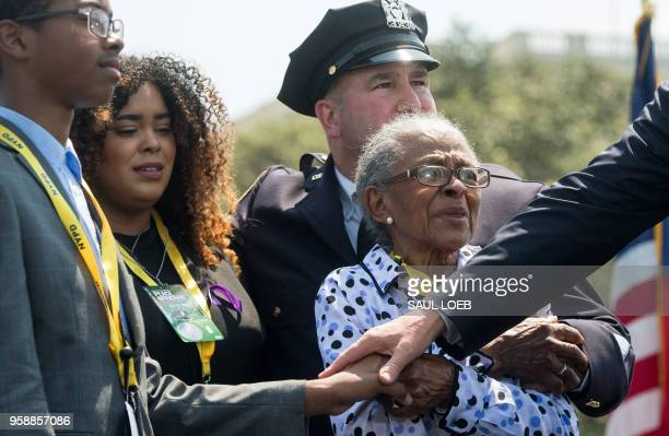 US President Donald Trump speaks near the children Peter and Genesis of fallen police officer Miosotis Familia and her mother Adriana Valoy during...