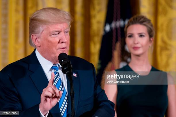 US President Donald Trump speaks next to his daughter Ivanka during an event with small businesses at the White House in Washington DC on August 1...