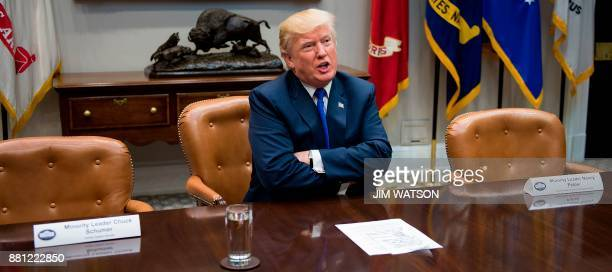 US President Donald Trump speaks next to the empty chairs of Senate Minority Leader Chuck Schumer DNew York after Schumer cancelled their meeting at...
