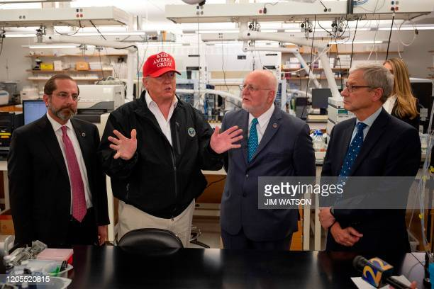 President Donald Trump speaks next to US Health and Human Service Secretary Alex Azar , CDC Director Robert Redfield , and CDC Associate Director for...