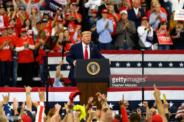 S President Donald Trump speaks on stage during a campaign rally at the Target Center on October 10 2019 in Minneapolis Minnesota The rally follows a...