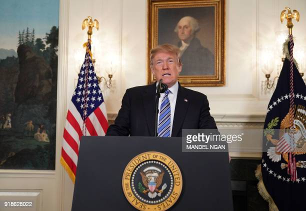 US President Donald Trump speaks on the Florida school shooting in the Diplomatic Reception Room of the White House on February 15 2018 in Washington...