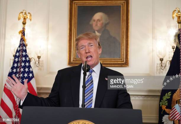 President Donald Trump speaks on the Florida school shooting in the Diplomatic Reception Room of the White House on February 15 2018 in Washington DC...