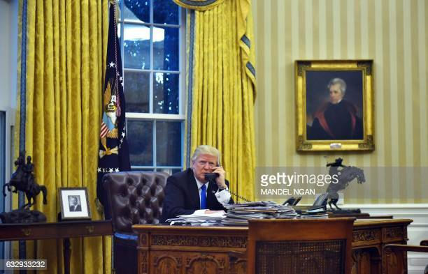 President Donald Trump speaks on the phone with Australia's Prime Minister Malcolm Turnbull from the Oval Office of the White House on January 28 in...