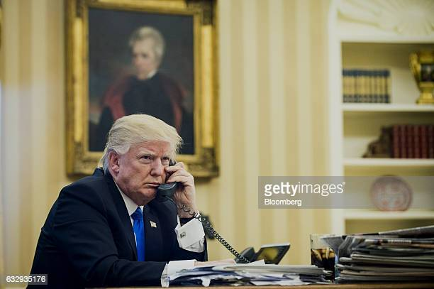 US President Donald Trump speaks on the phone with Malcolm Turnbull Australia's prime minister during the first official phone talks in the Oval...