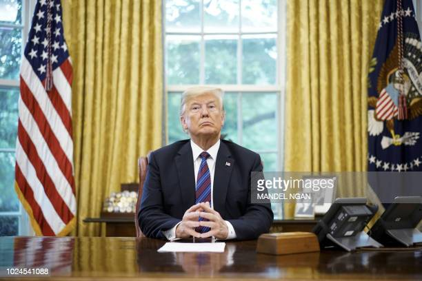 US President Donald Trump speaks on the phone with Mexico's President Enrique Pena Nieto on trade in the Oval Office of the White House in Washington...
