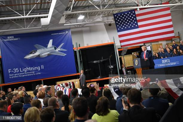 US President Donald Trump speaks on the United StatesMexicoCanada Agreement trade agreement at Derco Aerospace Inc plant in Milwaukee Wisconsin on...