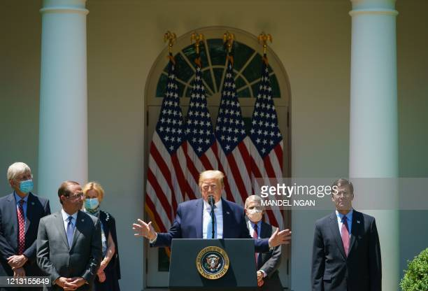 President Donald Trump speaks on vaccine development in the Rose Garden of the White House in Washington, DC on May 15, 2020. From left: National...