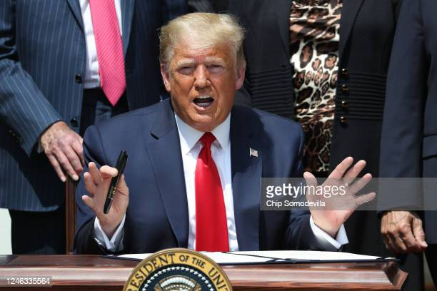 S President Donald Trump speaks prepares to sign the Paycheck Protection Program Flexibility Act in the Rose Garden at the White House June 05 2020...