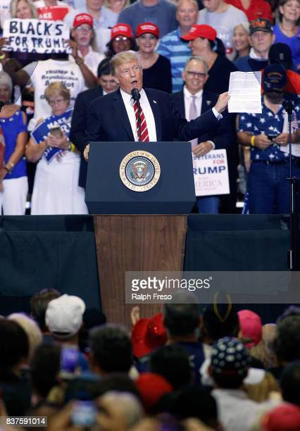 S President Donald Trump speaks to a crowd of supporters at the Phoenix Convention Center during a rally on August 22 2017 in Phoenix Arizona An...
