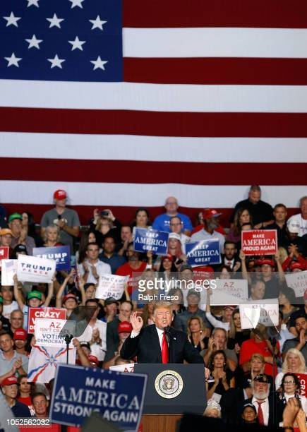 President Donald Trump speaks to a crowd of supporters during a rally at the International Air Response facility on October 19 2018 in Mesa Arizona...