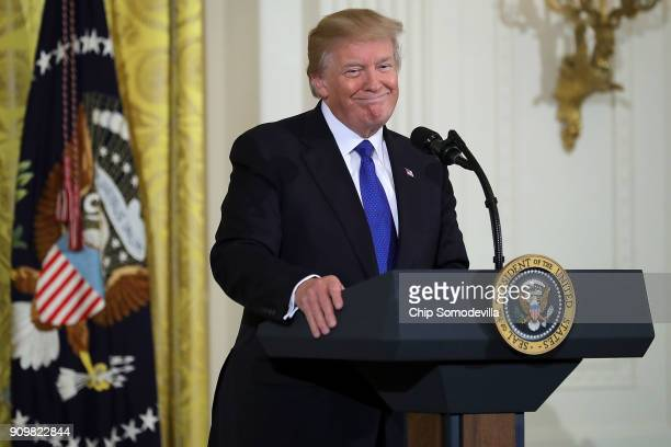 S President Donald Trump speaks to a group of mayors in the East Room of the White House January 24 2018 in Washington DC According to US Conference...