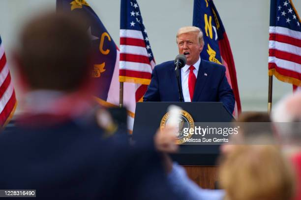 President Donald Trump speaks to a small crowd outside the USS North Carolina on September 2, 2020 in Wilmington, North Carolina. President Donald...
