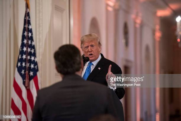 President Donald Trump speaks to Jim Acosta of CNN during a press conference in the East Room of the White House in Washington DC on November 7 2018