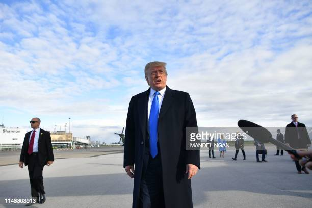 US President Donald Trump speaks to medias before boarding Air Force One at Shannon Airport in Shannon Ireland on June 6 2019 and fly to Normandy...