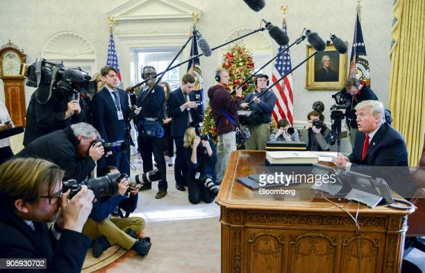 S President Donald Trump speaks to members of the media after signing a taxoverhaul bill into law in the Oval Office of the White House in Washington...