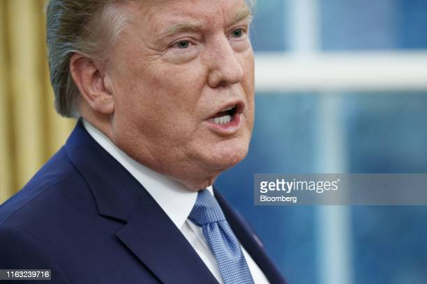 US President Donald Trump speaks to members of the media after presenting the Presidential Medal of Freedom to Robert Cousy former National...