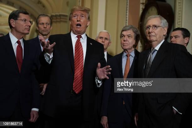 President Donald Trump speaks to members of the media as Sen. John Barrasso , Sen. John Thune , Vice President Mike Pence, Sen. Roy Blunt , Senate...