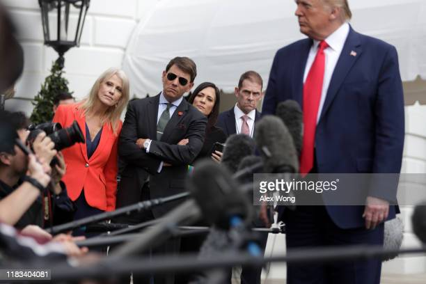 S President Donald Trump speaks to members of the media as White House Senior Counselor Kellyanne Conway Deputy Press Secretary Hogan Gidley and...