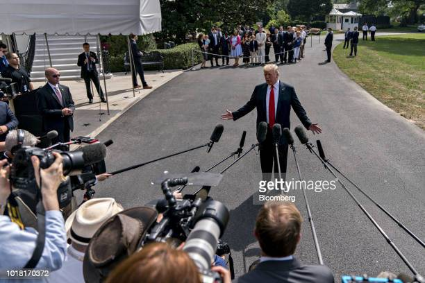 US President Donald Trump speaks to members of the media before boarding Marine One on the South Lawn of the White House in Washington DC US on...